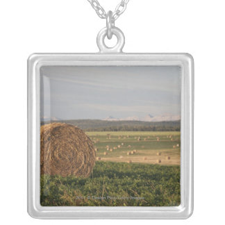 Hay Bales In A Field With Mountains At Sunrise Silver Plated Necklace