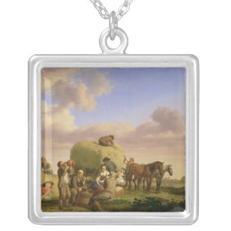 Haymakers resting in a field silver plated necklace
