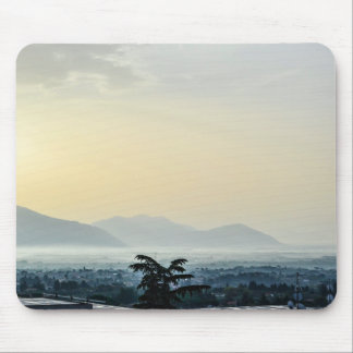 Hazy morning rooftops and a tall tree mouse pad