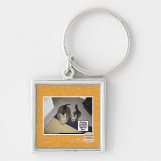 He sez hes big boned. Silver-Colored square key ring