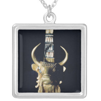 Head of a bull, decoration from a harp silver plated necklace
