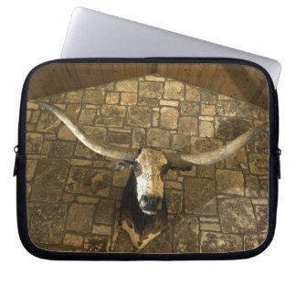 Head of longhorn steer mounted on wall laptop sleeve