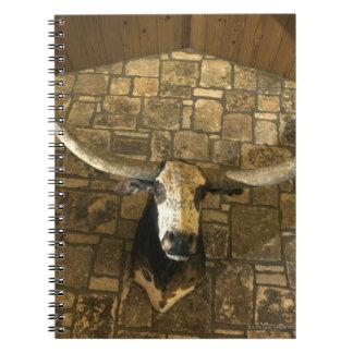 Head of longhorn steer mounted on wall notebook