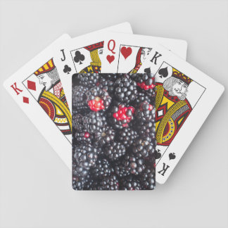 Heap of blackberries playing cards