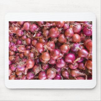 Heap of red onions on market mouse mat