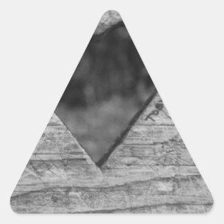 Heart cutout in wood triangle sticker