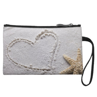 Heart Drawn in Sand at Beach w Starfish Template Wristlet Clutches