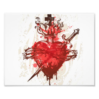 heart in flames wounded by dagger photograph