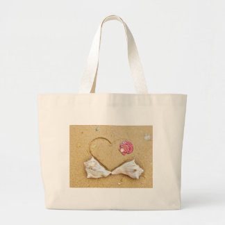 heart in the sand with shells tote bag