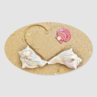 heart in the sand with shells oval sticker