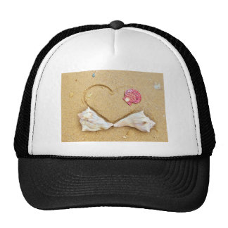 heart in the sand with shells trucker hat