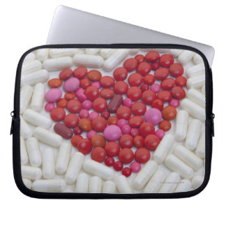 Heart made of red pills laptop sleeve