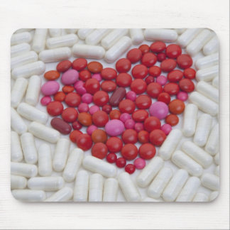 Heart made of red pills mouse mat