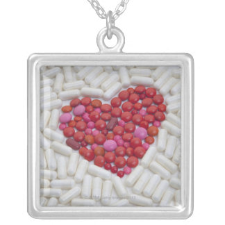 Heart made of red pills silver plated necklace