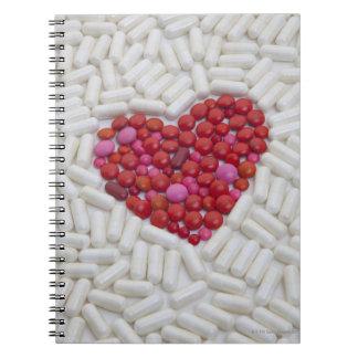 Heart made of red pills spiral notebook