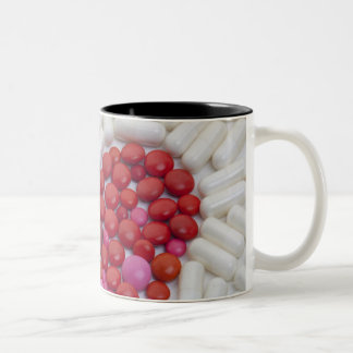 Heart made of red pills Two-Tone coffee mug