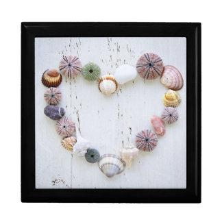 Heart of seashells and rocks gift box