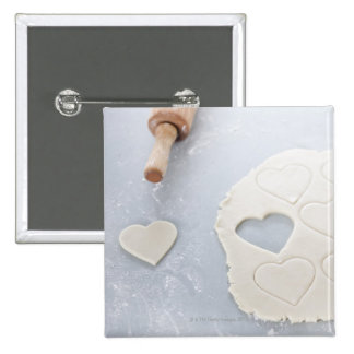 Heart shape cut out of a sheet of rolled out dough 15 cm square badge