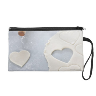 Heart shape cut out of a sheet of rolled out dough wristlet clutches