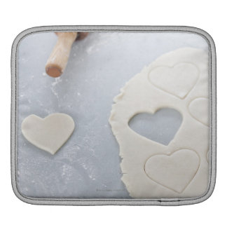 Heart shape cut out of a sheet of rolled out dough iPad sleeve