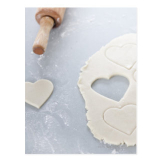 Heart shape cut out of a sheet of rolled out dough postcard