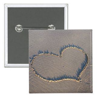 Heart shape drawn in the sand. 15 cm square badge