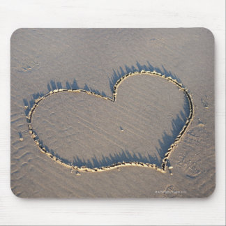 Heart shape drawn in the sand. mouse mat