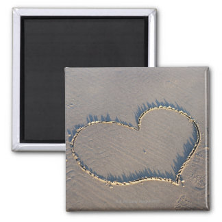Heart shape drawn in the sand. square magnet