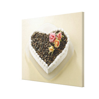 Heart shape wedding cake with flower, close-up canvas print