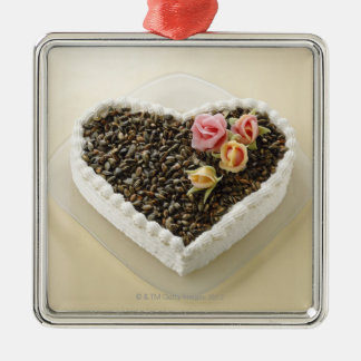 Heart shape wedding cake with flower, close-up Silver-Colored square decoration