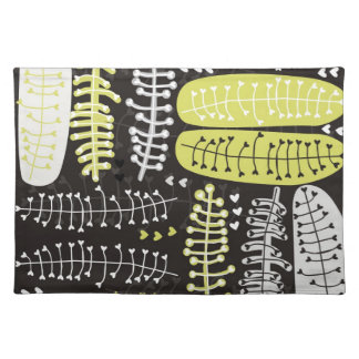heart shaped leaves gray black green on dark placemat