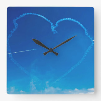 Heart-shaped plane trails wall clock