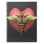 Heart symbol with medical symbol (caduceus) spiral notebook