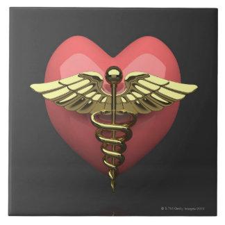 Heart symbol with medical symbol (caduceus) tile