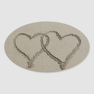 Hearts Drawn in Sand Oval Sticker