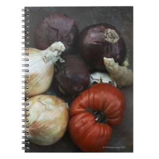 Heirloom tomato, yellow onion, red onion, ginger notebooks