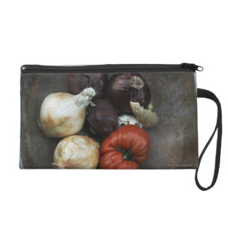 Heirloom tomato, yellow onion, red onion, ginger wristlet clutches