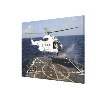 Helicopter lands aboard the Arleigh Burke-class Canvas Print