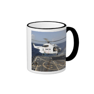 Helicopter lands aboard the Arleigh Burke-class Coffee Mug