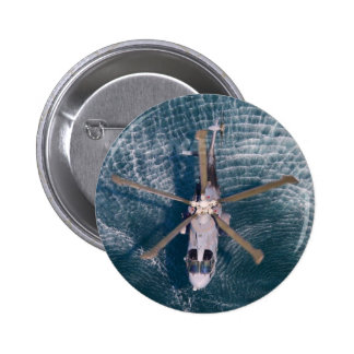 helicopter over water 6 cm round badge
