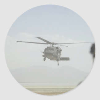 Helicopter picking up troops classic round sticker