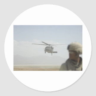 Helicopter picking up troops round stickers