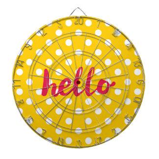 Hello on pastel yellow polka dots background dartboard