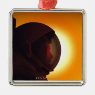 Helmeted Astronaut Against the Sun Christmas Ornament