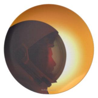 Helmeted Astronaut Against the Sun Plates