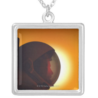 Helmeted Astronaut Against the Sun Silver Plated Necklace