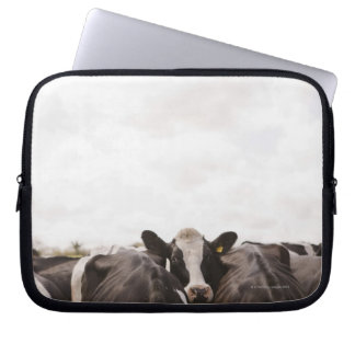 Herd of cattle and overcast sky laptop sleeve