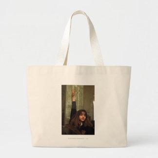 Hermione raises her hand canvas bag