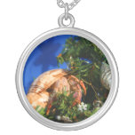 Hermit Crab in Tree blue background Necklaces
