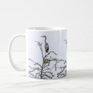 Heron on a tree coffee mug